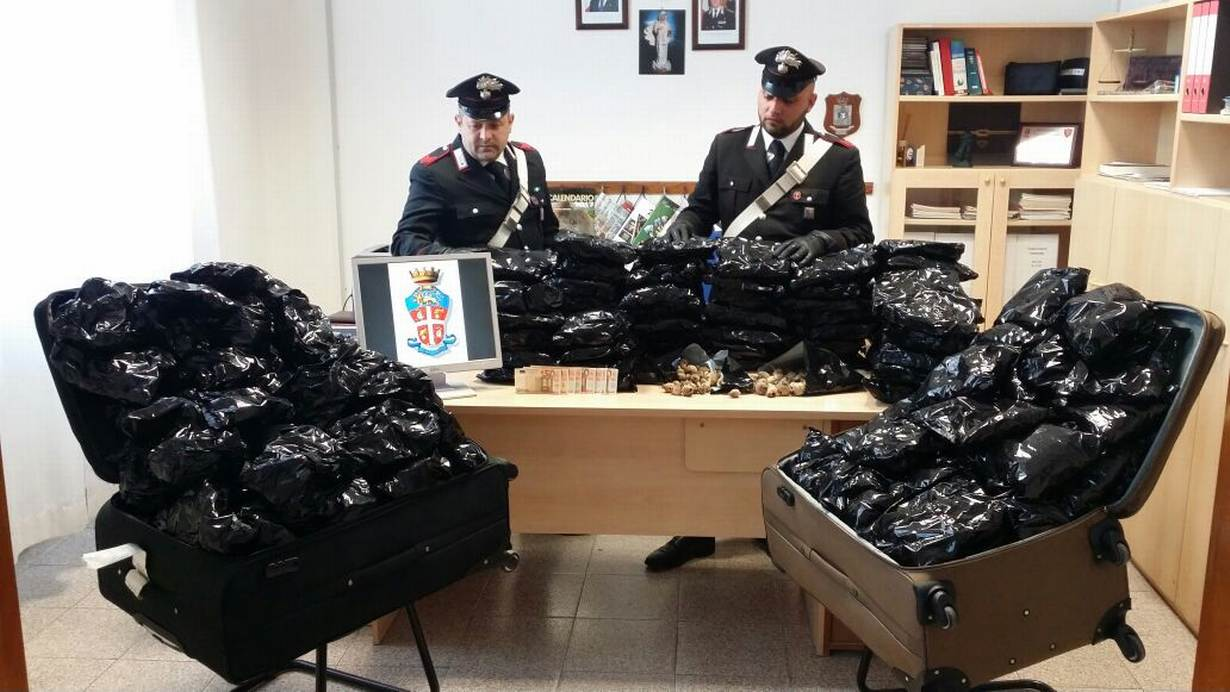 Police show 18 kg of dried poppy pods and cash seized during an arrest in Sabaudia, Latina, Italy. May 6, 2017. Police handout