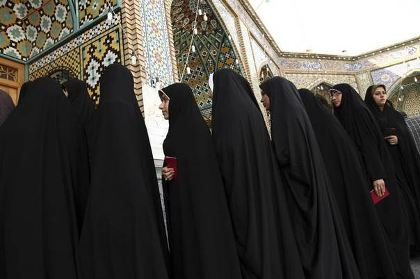 Women stand in line to vote during the Iranian presidential election at a mosque in Qom, 120 km (74.6 miles) south of Tehran June 14, 2013. REUTERS/Fars News/Mohammad Akhlagi