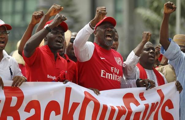 Members of the #BringBackOurGirls campaign group react during a rally denouncing the Nigerian police's ban on their daily protests, in Abuja, Nigeria, June 3, 2014. REUTERS/Afolabi Sotunde