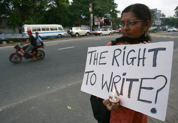 A woman takes part in a vigil for missing journalist Prageeth Eknaligoda in Colombo February 24, 2010. Eknaligoda, a pro-opposition journalist, disappeared on January 24, 2010 and his whereabouts is still unknown. REUTERS/Andrew Caballero-Reynolds