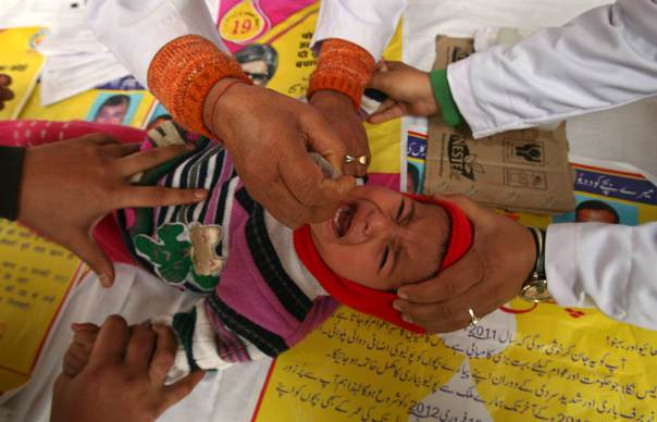A child receives polio drops during a polio eradication programme in Jammu, on Feb. 19, 2012. The polio eradication programme in India aims to immunise every child under five years of age with the oral polio vaccine. REUTERS/Mukesh Gupta
