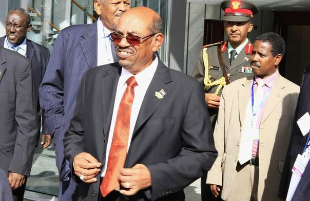 Sudan's President Omar al-Bashir leaves after the Extra Ordinary session on the Assembly of Heads of State and Government of the African Union on the case of African Relationship with International Criminal Court (ICC), in Ethiopia's capital Addis Ababa, October 12, 2013.