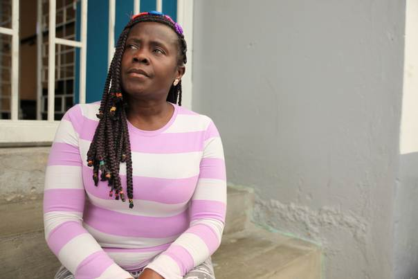 Francia Ibarguen, a survivor of gang rape by FARC rebels, sits on the steps of a community hall in Bogota, April 2014 THOMSON REUTERS FOUNDATION / Anastasia Moloney