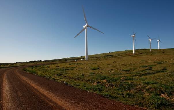 Giant wind turbines dot the landscape at the Darling Wind Power national demonstration project near Cape Town on July 17, 2009. REUTERS/Mike Hutchings