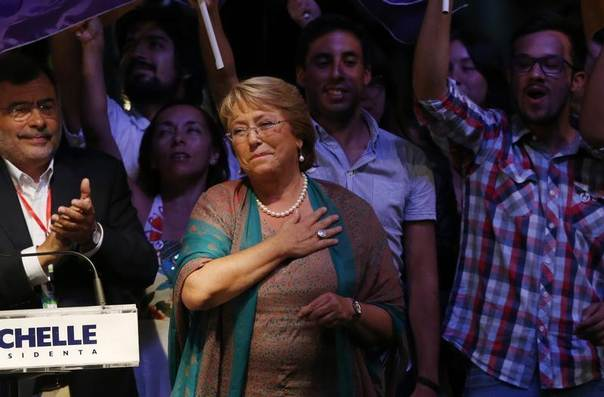 Chilean presidential candidate Michelle Bachelet celebrates after winning Chile's presidential elections, in Santiago, December 15, 2013. Bachelet was elected as Chile's president again on Sunday in a landslide victory that should hand the centre-leftist the mandate she sought to push ahead with wide-reaching reforms. REUTERS/Ivan Alvarado