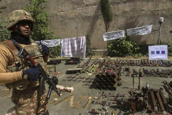 A Pakistani soldier stands by ammunition seized during a military operation against Taliban militants, in the of town of Miranshah, North Waziristan, Pakistan, July 9, 2014. REUTERS/Maqsood Mehdi