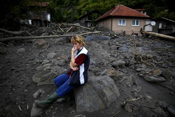 Fata Kovacevic reacts near her flood-damaged house in Topcic Polje, Bosnia and Herzegovina, May 20, 2014. REUTERS/Dado Ruvic