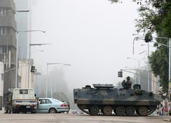 Military vehicles and soldiers patrol the streets in Harare, Zimbabwe