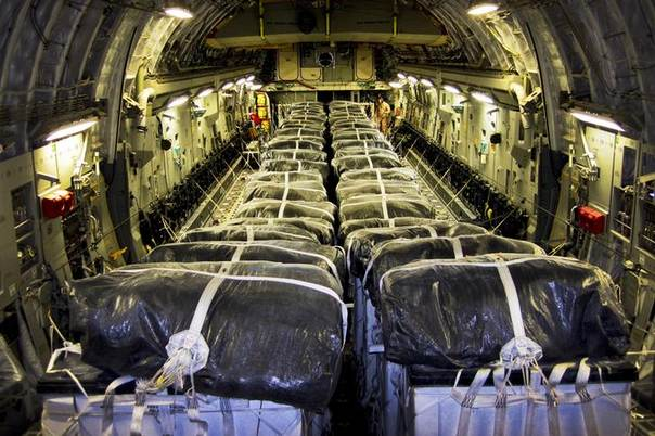 Water bundles are shown in a cargo plane at Al Udeid Air Base, Qatar, prior to a humanitarian air drop by the U.S. military over Iraq on August 8, 2014. REUTERS/U.S. Air Force photo by Staff Sgt. Vernon Young Jr./Handout