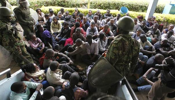 Riot police detain University of Nairobi students who were rioting in protest against plans to raise fees and cut loans. Picture Nairobi, May 20, 2014. REUTERS/Thomas Mukoya