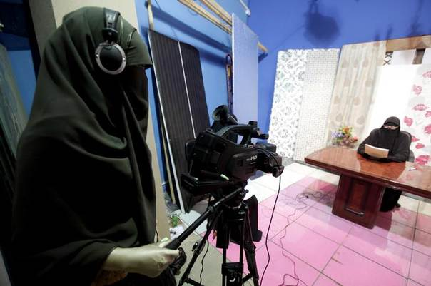 A video woman records a program in a studio of a new TV channel which is being managed and run exclusively by women who wear the full veil, to be launched this weekend, in Cairo July 19, 2012. REUTER/Mohamed Abd El Ghany