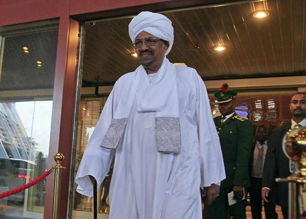 Sudanese President Omar al-Bashir walks out of a hotel in Abuja July 14, 2013. Al-Bashir arrived in Nigeria on Sunday for an African Union summit on HIV/AIDS as his hosts chose to ignore an International Criminal Court (ICC) arrest warrant against him. REUTERS/Afolabi Sotunde