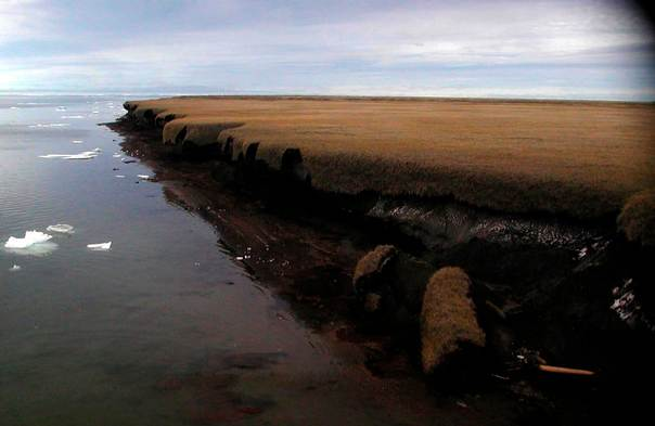 A handout photo from 2004 shows coastal erosion of mud-rich permafrost along Beaufort Sea coastline at Drew Point in Alaska. REUTERS/USGS/Gary Clow/Handout