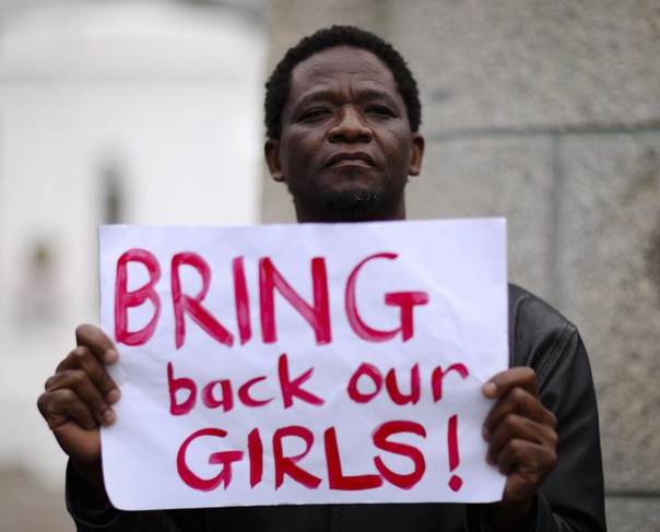 A protester holds a sign during a march in support of the girls kidnapped in Nigeria by members of Boko Haram, in Cape Town May 8, 2014. REUTERS/Sumaya Hisham
