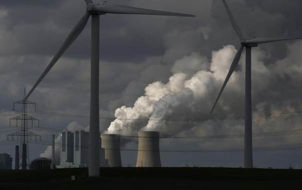 Wind turbines are seen in front of a coal power plant of German utility RWE Power near the western town of Neurath on February 28, 2014. REUTERS/Ina Fassbender