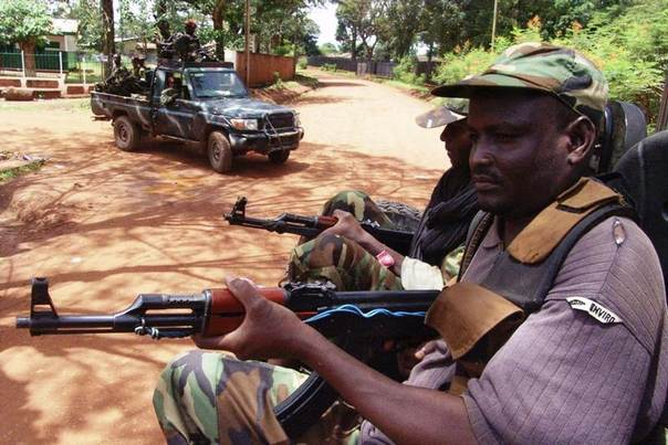 Armed fighters from the Seleka rebel alliance patrol the streets in pickup trucks to stop looting in Bangui, March 26, 2013. REUTERS/Alain Amontchi