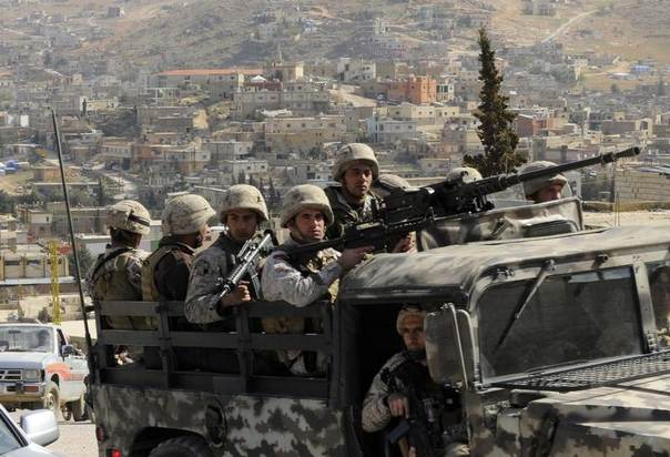 Lebanese army soldiers patrol on their armoured vehicle the Sunni Muslim border town of Arsal, in eastern Bekaa Valley, Lebanon, March 20, 2014. REUTERS/Hassan Abdallah