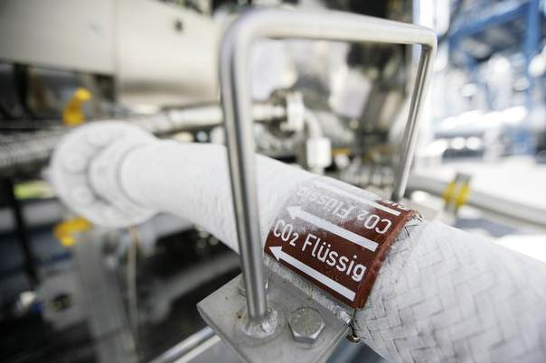 A flexible tube for CO2 is connected to a truck before the first official run of the