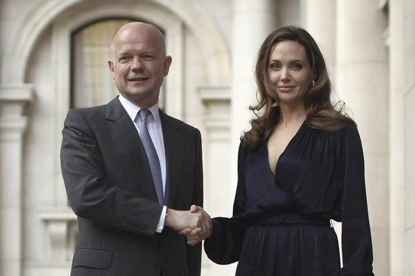 U.S. actress and director Angelina Jolie greets Britain's Foreign Secretary William hague ahead of a screening of her new film 'In the Land of Blood and Honey' at the Foreign Commonwealth Office in central London, May 29, 2012.  REUTERS/Pool/Dan Kitwood