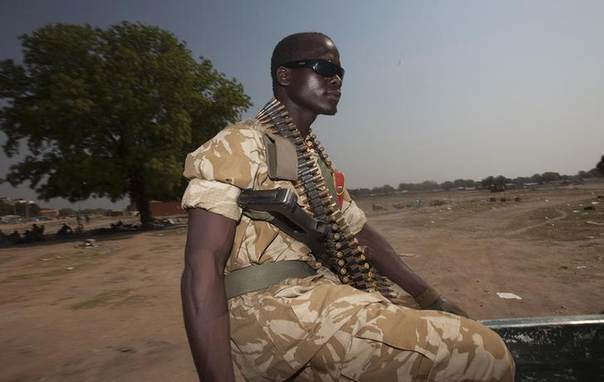 A soldier from the SPLA rides on a pick-up truck as they patrol around Bor, South Sudan, January 27, 2014. REUTERS/George Philipas