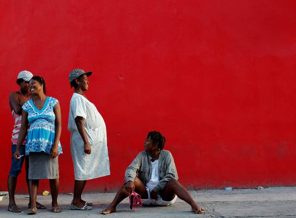 Pregnant women wait in line for tent distribution in Port-au-Prince, on Feb. 19, 2010. REUTERS/Carlos Barria