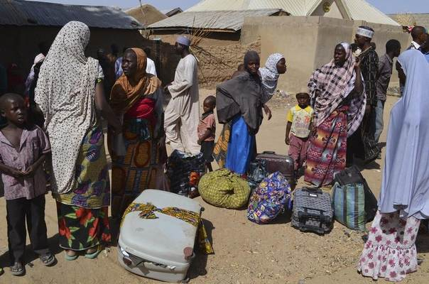 Families from Gwoza, Borno State, displaced by the violence and unrest caused by the insurgency, are pictured at a refugee camp in Mararaba Madagali, Adamawa State, Nigeria, February 18, 2014. REUTERS/stringer
