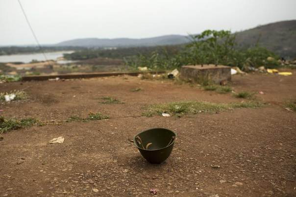 A military helmet is pictured on the ground in Camp de Roux, a main base recently abandoned by former Seleka fighters near the centre of the capital Bangui January 28, 2014. REUTERS/Siegfried Modola