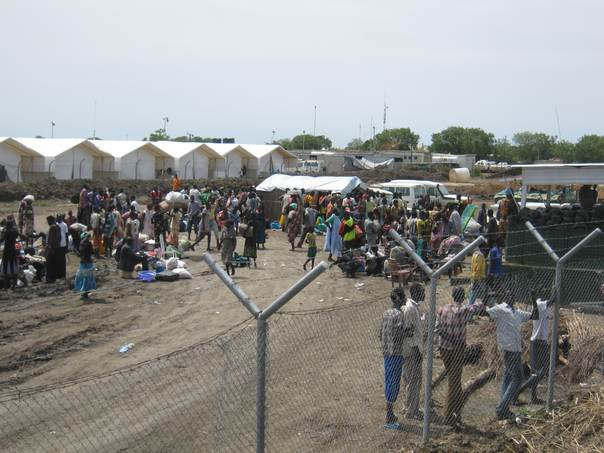 People enter the Protection of Civilians (POC) site with whatever possessions they could carry in Bentiu, South Sudan after opposition forces took control of the city on April 15. Photo: Tom Dobbin/Concern Worldwide
