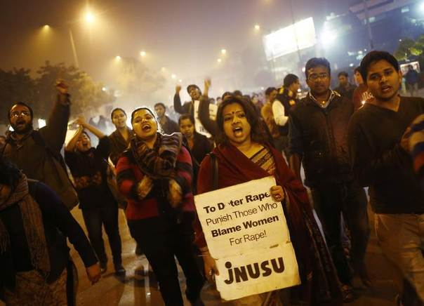 Demonstrators shout slogans during a candlelight vigil on the first anniversary of the gang rape of a 23-year-old women - who later died of her injuries - in New Delhi. Picture December 16, 2013, REUTERS/Anindito Mukherjee