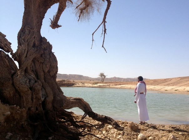 Mahri tribesman by a reservoir, Yemen
