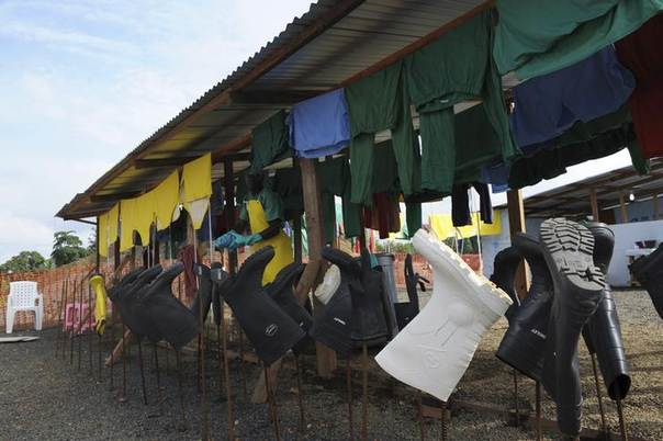 Protection clothing and boots belonging to Medecins Sans Frontieres (MSF) health workers are seen drying outside an isolation unit in a hospital in Liberia's capital Monrovia August 23, 2014. REUTERS/2Tango