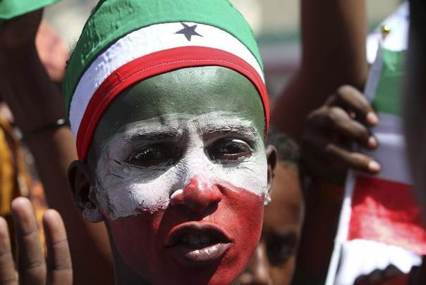 A Somaliland resident with his face painted in their national colours joins a procession during celebrations to mark the 22nd anniversary of Somaliland's self-declared independence from the larger Somalia, in Hargeisa May 18, 2013. REUTERS/Feisal Omar