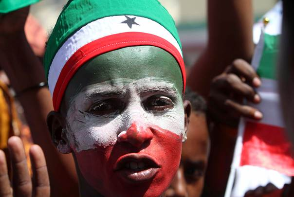 A man with his face painted in Somaliland's national colours joins a procession during celebrations to mark the 22nd anniversary of Somaliland's self-declared independence from Somalia, in Hargeisa, on May 18, 2013. REUTERS/Feisal Omar
