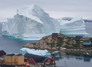Huge iceberg drifts close to Greenland village, causing fears of a tsunami