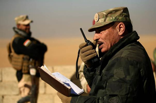 Nineveh Operations Commander Major General Najm al-Jubbouri uses a