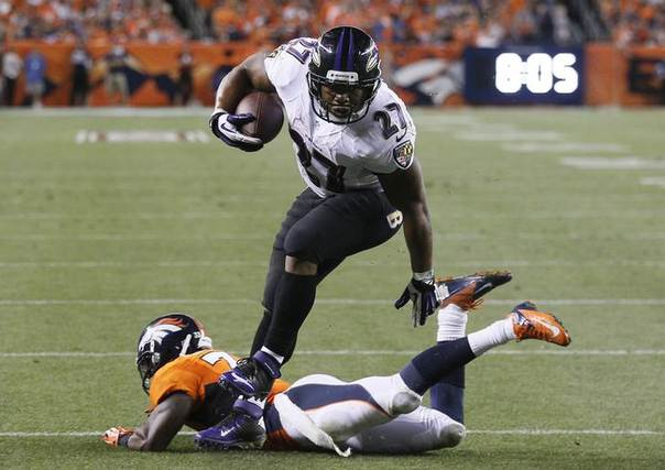 Baltimore Ravens Ray Rice (27) avoids a tackle by Denver Broncos Duke Ihenacho (33) to score a touchdown during the second quarter in their NFL football game in Denver, Colorado September 5, 2013. REUTERS/Rick Wilking