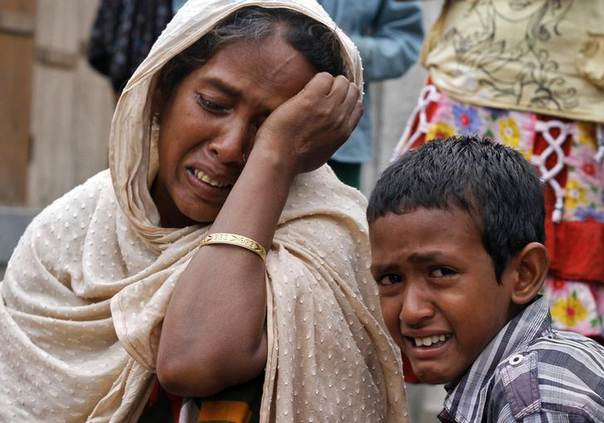 Villagers from Muslim communities affected by ethnic violence weep at a relief camp in Narayanguri village in Baksa district in the northeastern Indian state of Assam May 4, 2014 REUTERS/Utpal Baruah