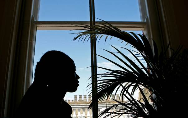 In a 2008 file photo, a Rwandan woman who was brought from Africa to a south London apartment and forced to have sex while her captor collected her earnings, is seen at the Helen Bamber Foundation in central London. REUTERS/Alessia Pierdomenico