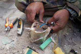 Mines still claim legs and lives in Libya's Benghazi, months after war ceased