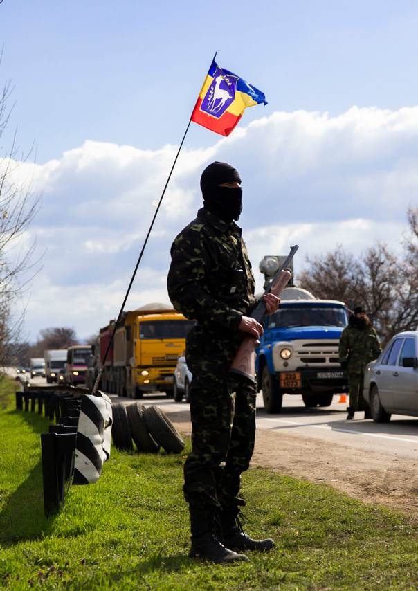 An armed member of a local self-defense unit mans a