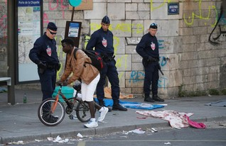 Police evict thousands of migrants from Paris sidewalks for second time since July