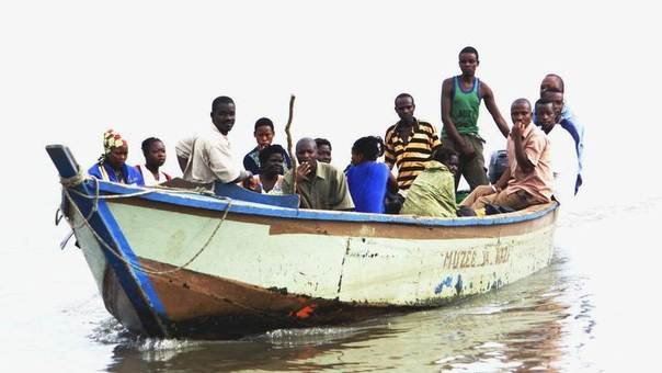 This photo from 2003 shows Congolese refugees from eastern DRC on Lake Albert arriving at the border town of Ntoroko in Uganda after fleeing fighting in the Ituri region. REUTERS/Patrick Olum