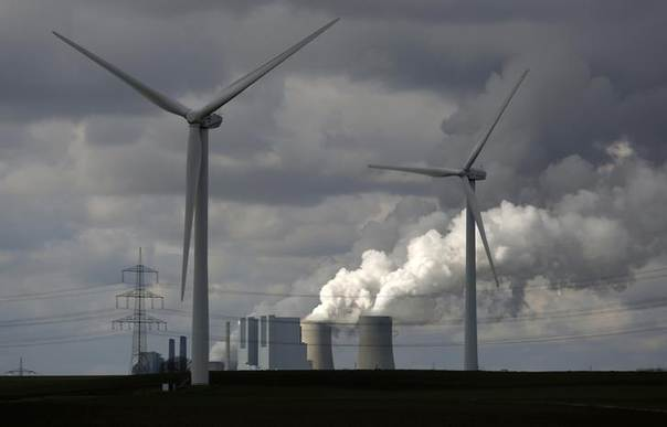 Wind turbines are seen in front of a coal power plant of German utility RWE Power near the western town of Neurath February 28, 2014. REUTERS/Ina Fassbender