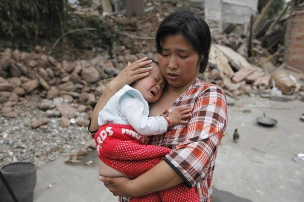 Earthquake survivor Chen Zhirong comforts her son