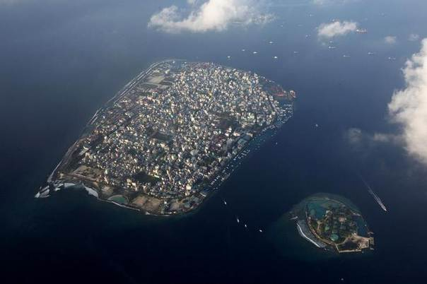 An aerial view of Male, capital of the Maldives, a group of low-lying atolls and islets whose fishing and tourism are being hit by climate change. Picture December 14, 2009, REUTERS/Reinhard Krause