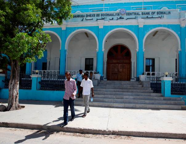 People walk outside Somalia's central Bank in Hamarwayne district, south of capital Mogadishu. REUTERS/Omar Faruk
