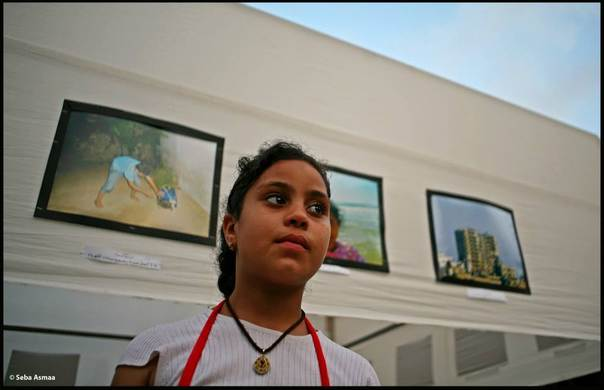 """Walla Draz, eight years old is one of the 6 children who participated in the project. Photographed at the exhibition of """"Gaza: Through the eyes of Children"""", held in Gaza on the 18 July 2012. Asmaa Seba"""