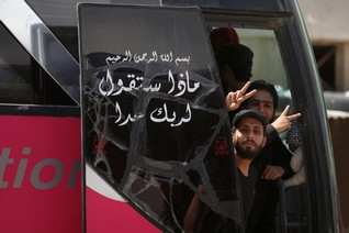 Syrian rebels begin to leave last opposition-held Homs district
