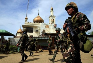 Philippine president urges IS-linked rebels to halt siege, start talks