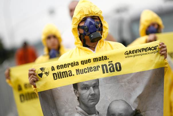 Greenpeace activists hold a demonstration against nuclear energy in front of Planalto Palace in Brasilia on March 18, 2011. The poster reads,